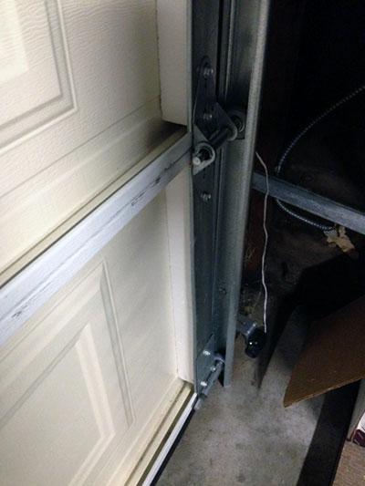 Door off track garage door repair sacramento ca for Garage door repair sacramento